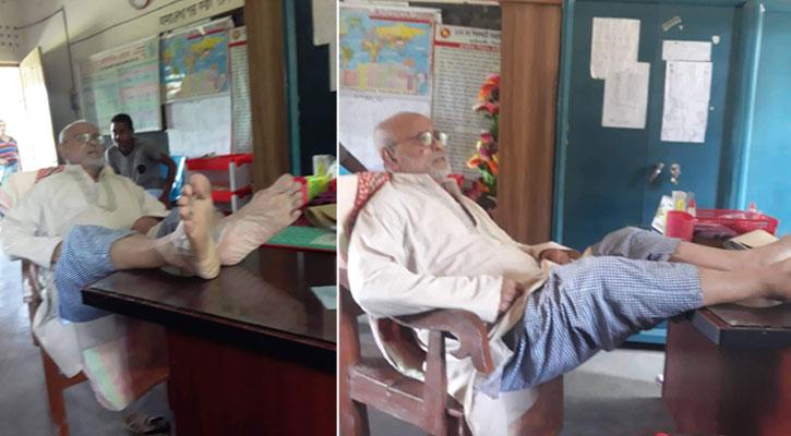 প্রধান শিক্ষকের টেবিলে পা তুলে বসলেন স্কুলের জমিদাতা!